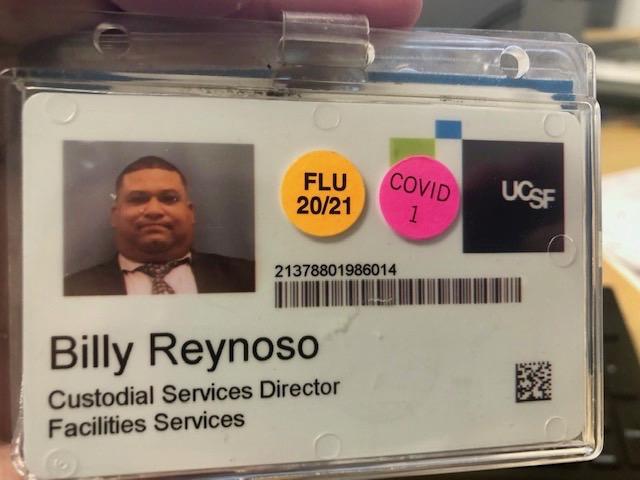 Billy Reynoso's COVID sticker on his ID.