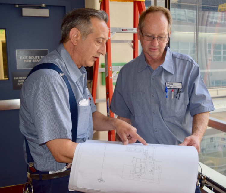Paul and Doug Bauer inspect plans on the job.