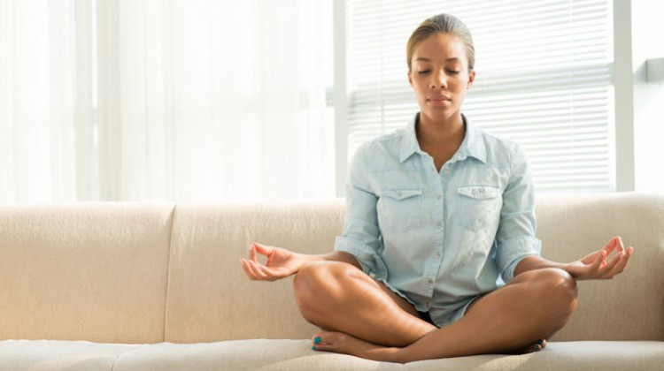 woman-meditating-couch.jpg