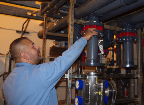 James Place, Assistant Chief Engineer shows how the water flows through the UV filter