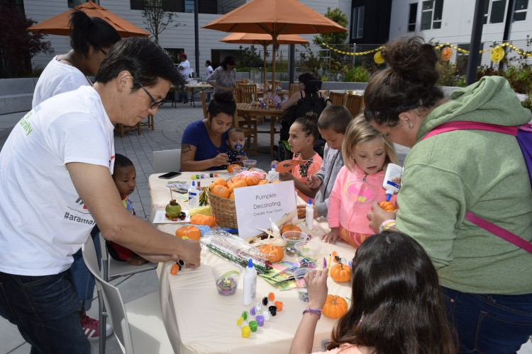 Photo of children pumpkin decorating