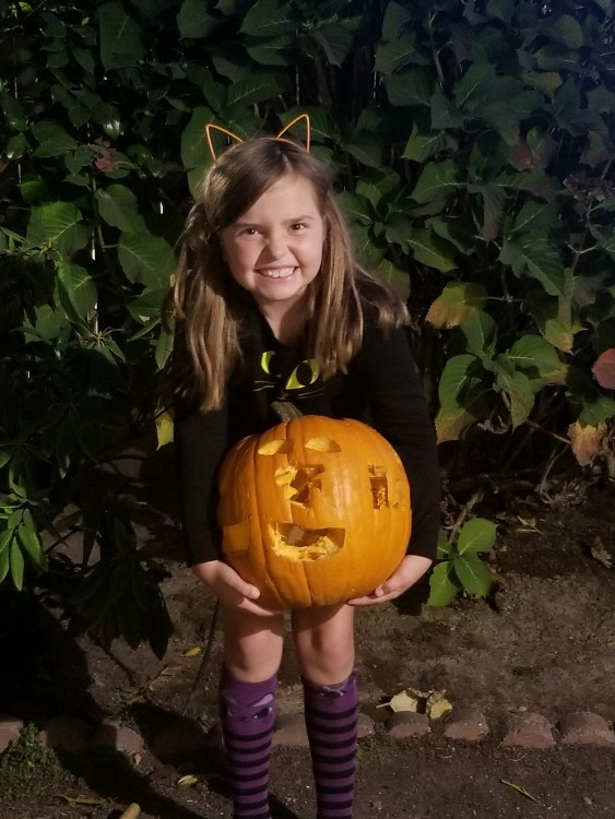 Child with a pumpkin.