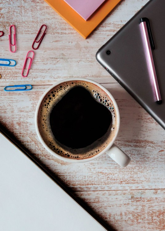 Ipad and coffee on table.
